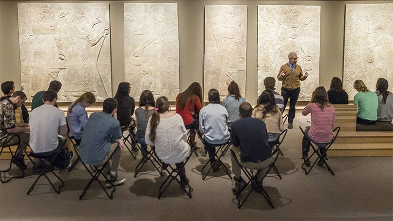Professor Steven Kangas talks with his class about the ancient Assyrian reliefs at the Hood Museum of Art
