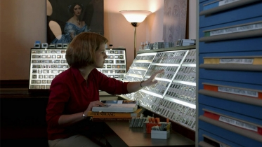 Kristina Kleutghen, Class of 2003, looks at slides in the Art History department's slide collection in Carpenter Hall